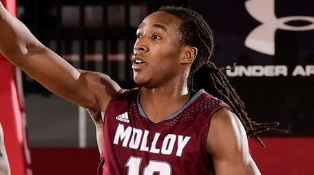 Curtis Jenkins of Molloy reacts to the play