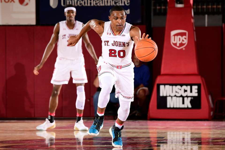 Marcus LoVett of St. John's handles ball on