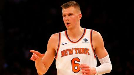 Kristaps Porzingis of the Knicks reacts after hitting