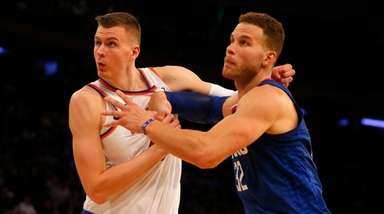 Kristaps Porzingis of the Knicks battles for position against