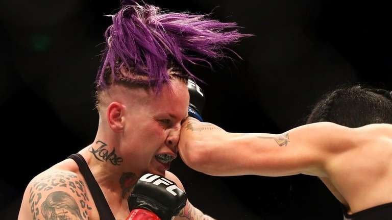 Bec Rawlings (L) of Australia is punched by