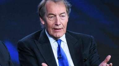 Charlie Rose sits on a