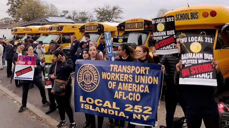 Striking members of TWU Local 252 rally in