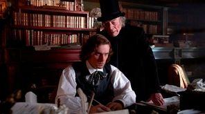 Dan Stevens, left stars as Charles Dickens and