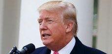 Barron Trump listens as President Donald Trump speaks