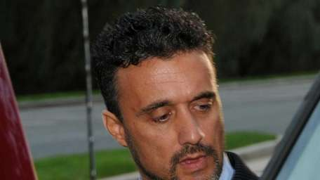 Nicholas Cosmo leaves federal court in Central Islip
