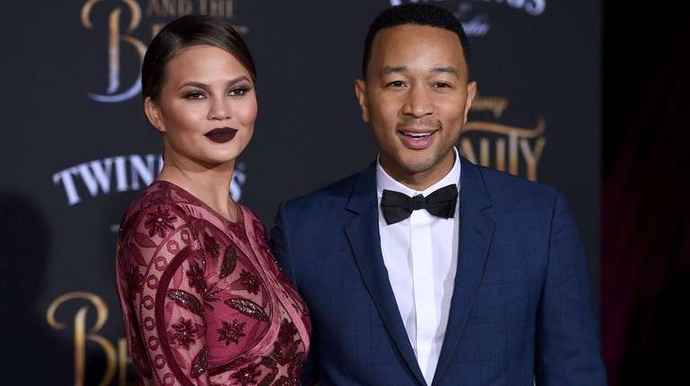 Chrissy Teigen and John Legend arrive at the