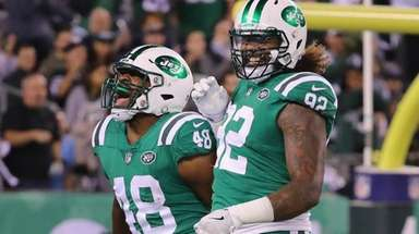 Jets outside linebacker Jordan Jenkins celebrates his sack with