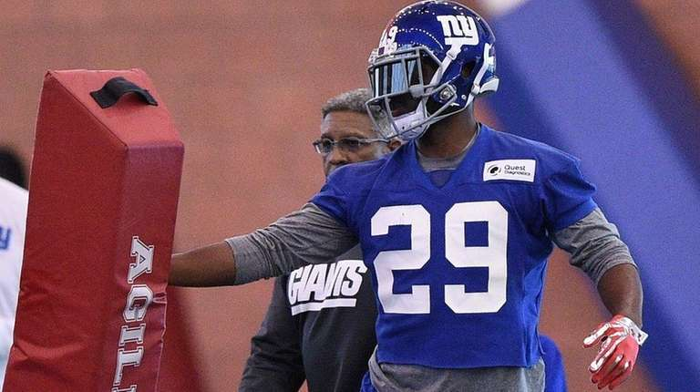 Giants safety Nat Berhe participates in drills during minicamp