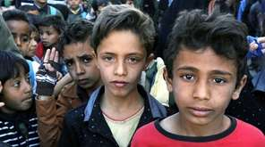 Yemeni children take part in a protest against