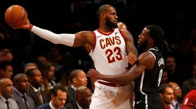 The Cavaliers' LeBron James controls the ball against