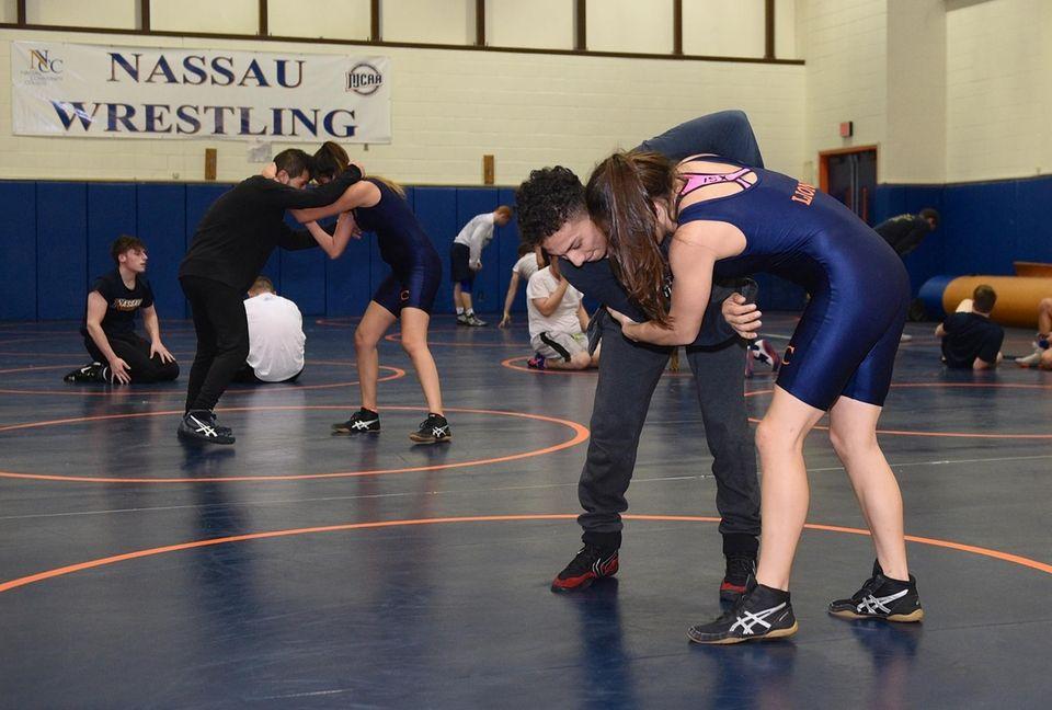 Nassau Community College women's wrestler Kristen Walsh, right,