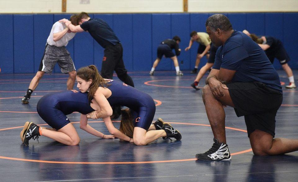 Nassau Community College women's wrestlers Kristen Walsh, right,