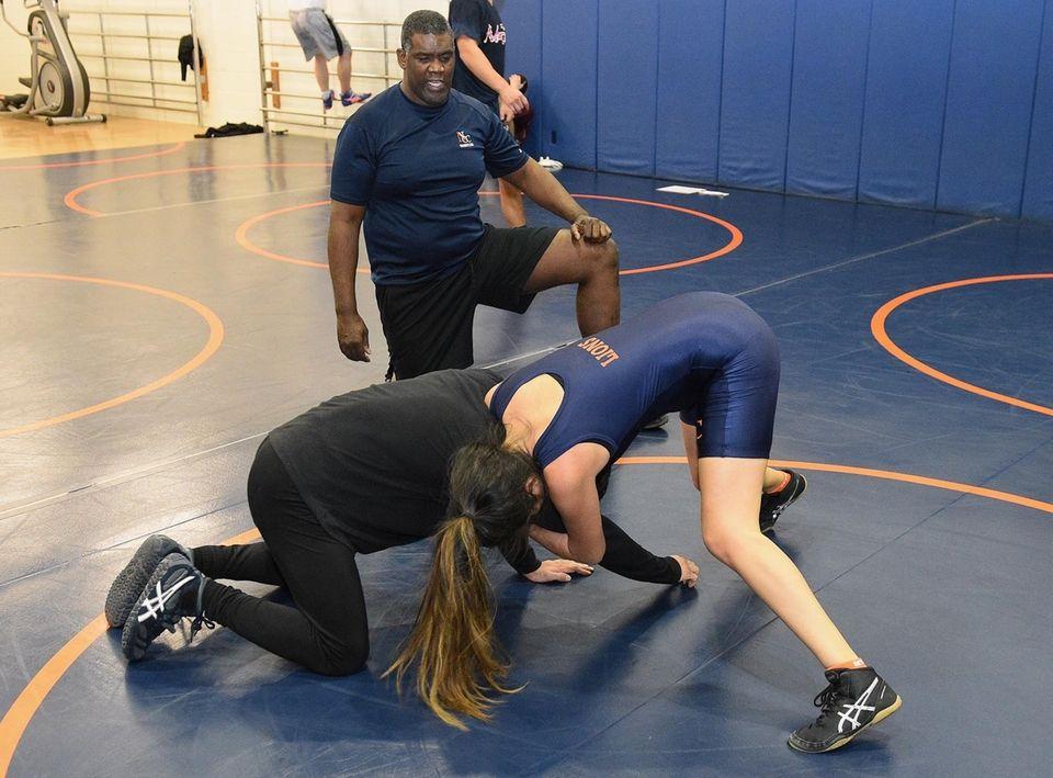 Nassau Community College women's wrestler Carolyn Herrera practices