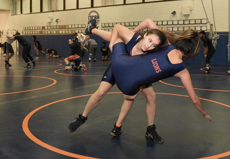 Nassau Community College women's wrestlers Kristen Walsh, facing,
