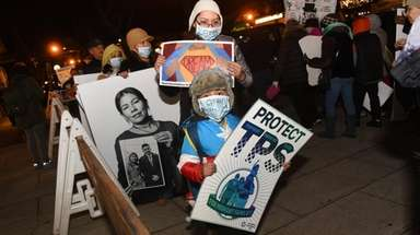 Hiroshi Sandoval, 5, of Westbury, center, with mom