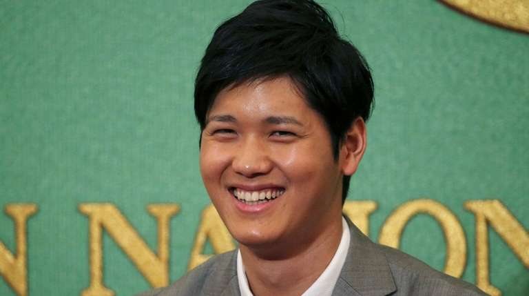 Japanese pitcher-outfielder Shohei Ohtani smiles during a press