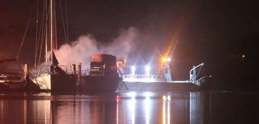 The scene of a fire involving four boats