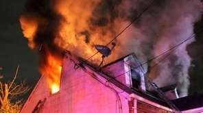 An early morning fire engulfs a house in