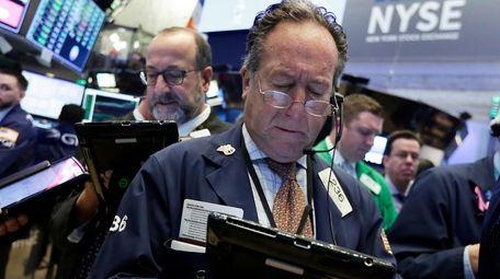 Trader Steven Kaplan, right, on the floor of