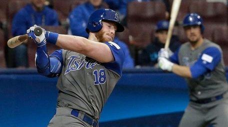 Israel's Zach Borenstein hits an RBI single against