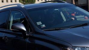 An Uber driver pulls into the Hicksville LIRR