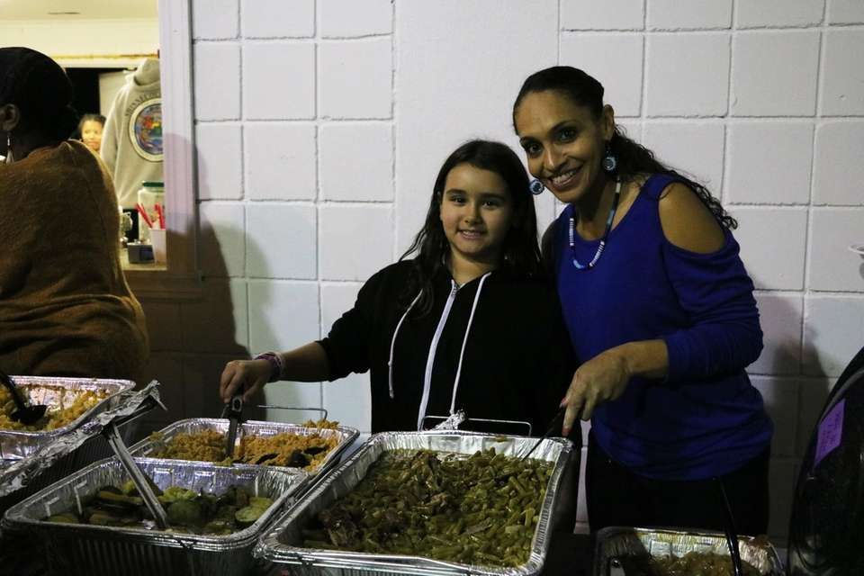 Members of the Shinnecock tribe serve food at