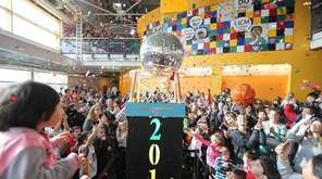 A Times Square-style ball drop is held at