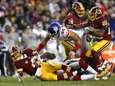 Kirk Cousinsof the Redskins is sacked by Olivier