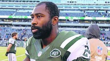 Jets cornerback Darrelle Revis walks on the field