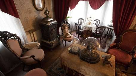 The back parlor of the Conklin Museum in