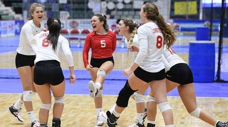 The Connetquot girls volleyball team celebrates after winning