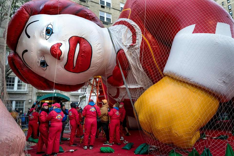 The Ronald McDonald balloon is inflated along 79th