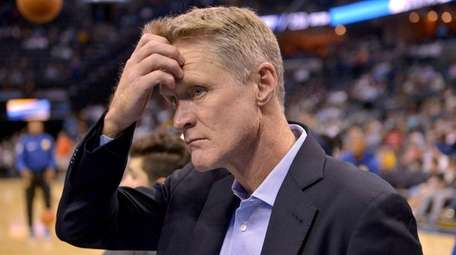 Warriors head coach Steve Kerr walks onto the