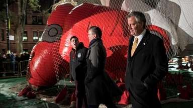 New York Mayor Bill de Blasio, center, arrives