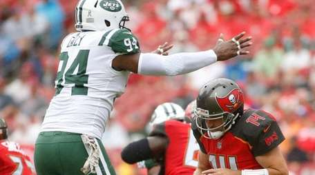 Jets defensive end Kony Ealy puts pressure on