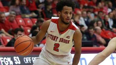 Stony Brook guard Michael Almonacy moves the ball up