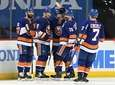 Islanders players celebrate the game-winning goal by Josh