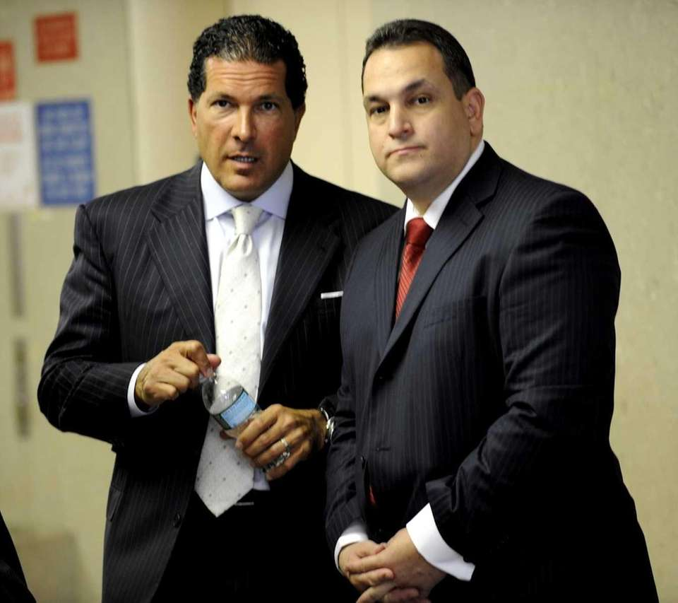 Hiram Monserrate, right, and his lawyer talk during