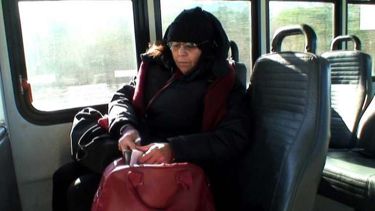 Gloria Richmond rides the bus to visit her