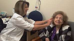 Sally Lepis of Selden gets hearing aids from