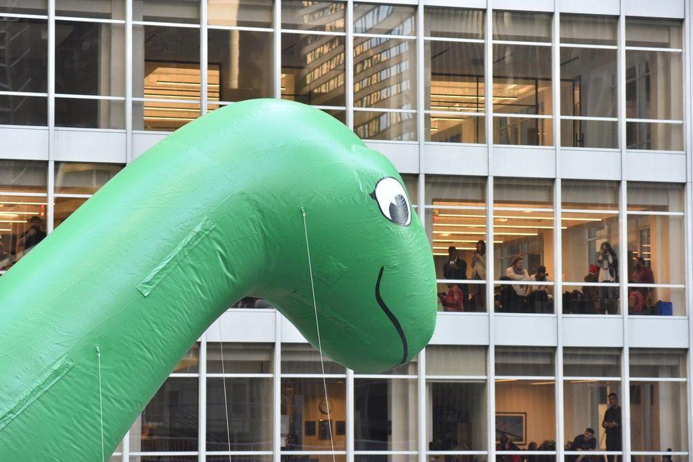 Sinclair Oil's Dino balloon makes eye contact in
