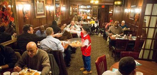 Veterans enjoy a free Thanksgiving dinner on Thursday,