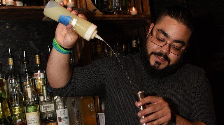 Steven Ferreira prepares drinks at Cork & Kerry