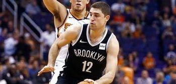 Brooklyn Nets guard Joe Harris (12) dribbles the