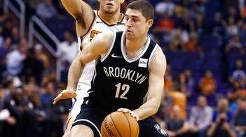 Brooklyn Nets guard Joe Harris (12) dribbles the