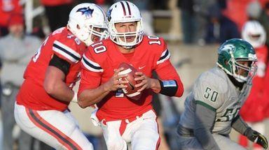 Stony Brook quarterback Joe Carbone scrambles against Wagner