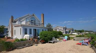 This Bayville compound offers a five-bedroom house and