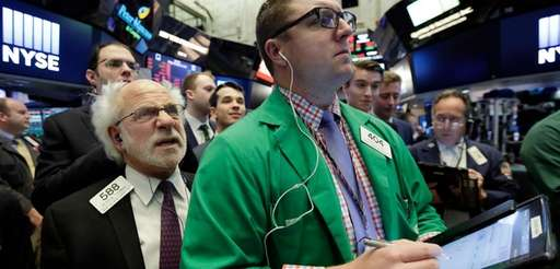 Traders Peter Tuchman, left, and Ryan Falvey work