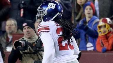 Giants cornerback Janoris Jenkins, right, intercepts a pass